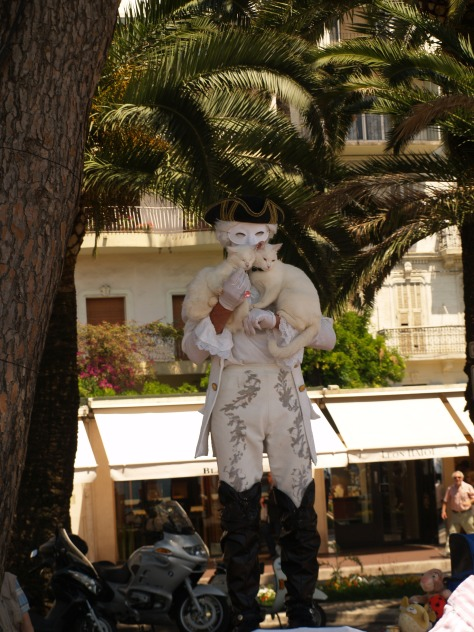 Mime artist with cats.He did assure me the cats were enjoying themselves.Hmmm not sure though.