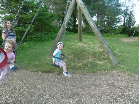 My niece and nephew on the swings at the adventure playground on the campsite.