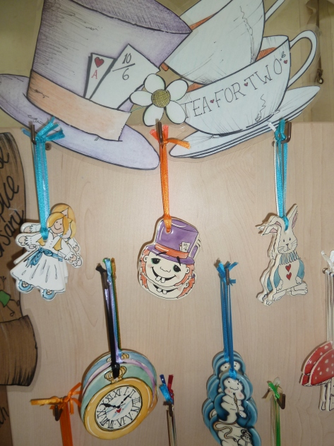 Lisa uses wooden boards with hooks to display her ceramic tags.