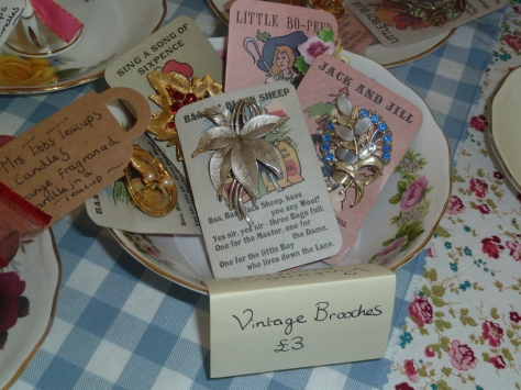 I have attached these pretty brooches to vintage playing cards.