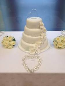 The gorgeous wedding cake was made by the brides very talented sister Robin.