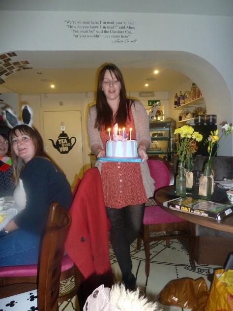 Liz brings in the cake.