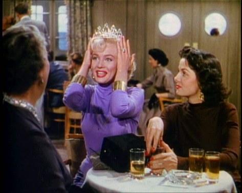 Lorelei tries on a diamond tiara.