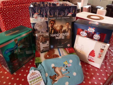Christmas Eve box contains ~ boozy gifts ( reduced at sainsburys), Lidl Gingerbread and chocs, The Hangover 3 on dvd, Pants for poverty boxers ( for him) and snuggly fawn hot water bottle ( for me) :)