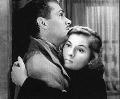 Lawrence Olivier and Joan Fontaine star in Rebecca.