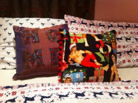 Amy's bed is full of cushions that her Mum made. Loving the saucy santa !