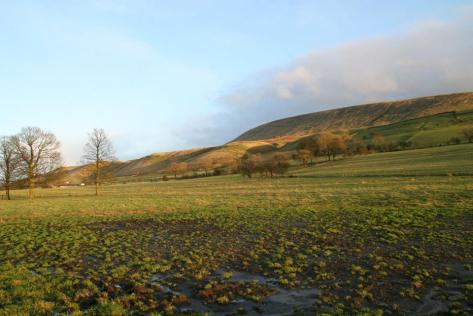Muddy fields and Pendle Hill ( photo~ Ian Neilson)