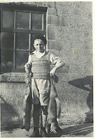 And here's my Dad as a boy. Looks like he's been out Foxing. :(  It was simply part of growing up in the country in those days. ( late 1940s).