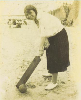 Great Aunt Lily playing cricket on Southport beach.