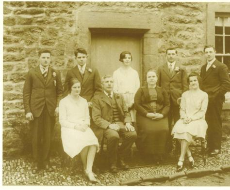 Here are my paternal Great Grandparents posing with their offspring outside in the farm yard. Sad there are no sheep dogs in the picture. :(