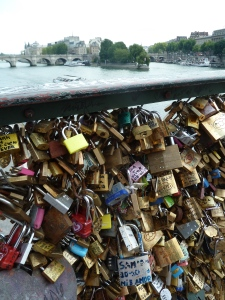 Love locks on the Pont des arts bridge over the river seine.