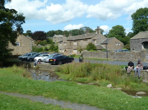 The village brook. Popular  for paddling and picnicking.