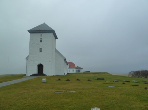 Pretty church looking out onto a fog obscured sea.