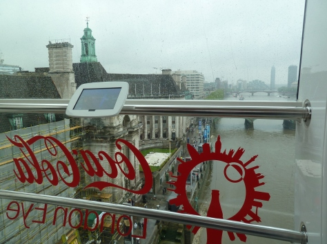 On the London Eye in the rain.