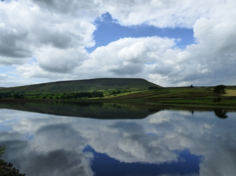 Pendle Hill reflected in the reservoir.